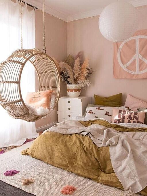 bedroom-pink-walls-rattan-hanging-chair-nordroom